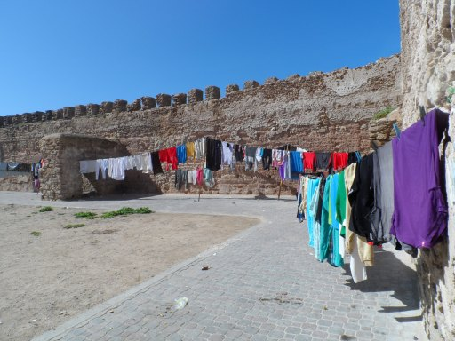 I love that people are actually living in the ruins. Their laundry is hanging from fortress walls built in the 16th century.