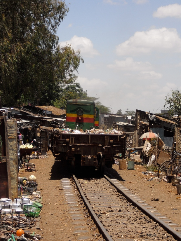 Before the train came through, there was an open market of stales lined up on the tracks. The people have learned how to close up shop in a matter of seconds.